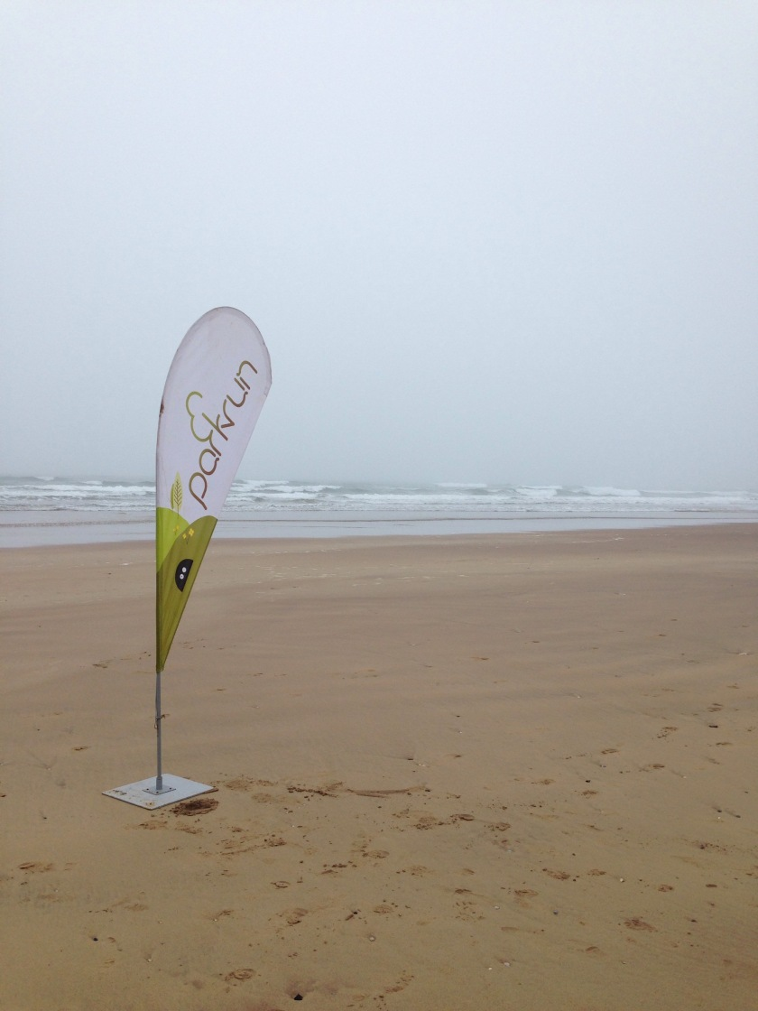 Parkrun flag on Portrush beach
