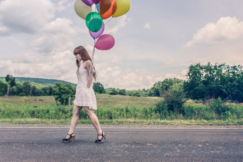 Woman walking with balloons