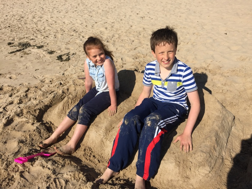 kids on sand sofa